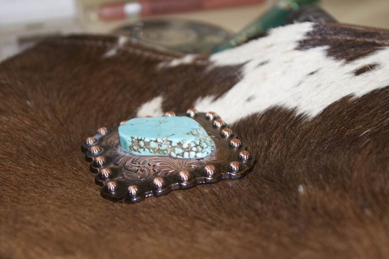 Turquoise detail on cowhide bag