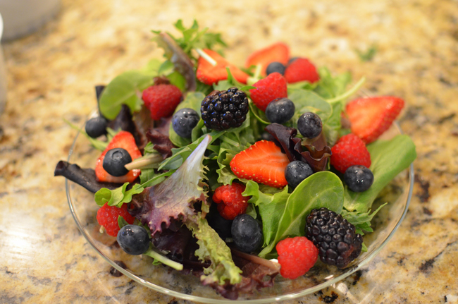 greens with berries