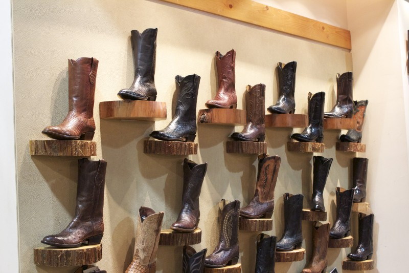 cowboy boot wall inside Pinto Ranch