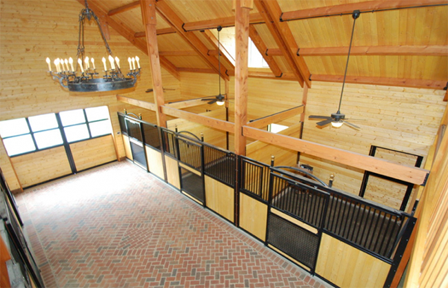 Interior shot of the stable with beautiful brick aisles