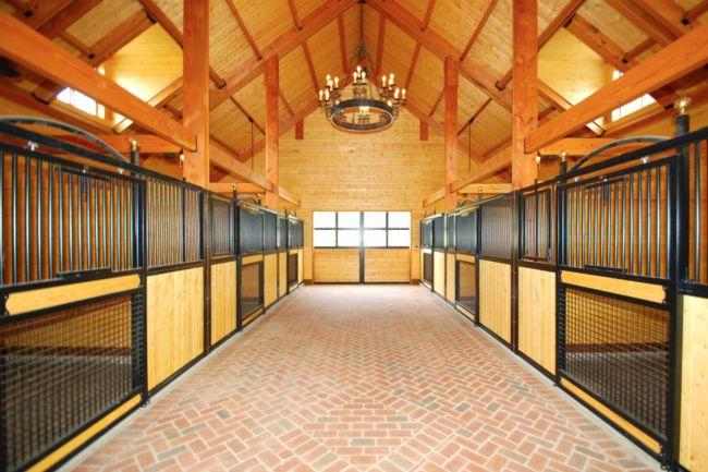 Large brick barn aisle and spacious stalls