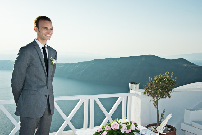 The handsome groom waiting for his bride in Santorini, Greece