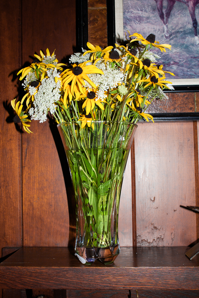 Fresh picked wild flowers on the mantle
