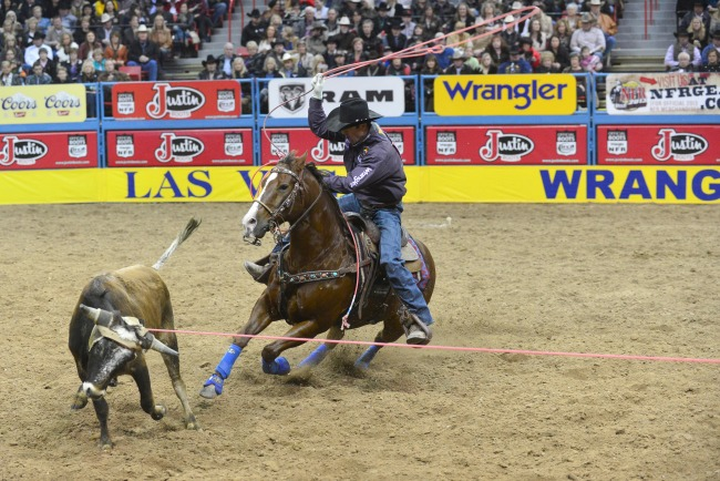 Dugan Kelly at the NFR riding in Western Dove Tack