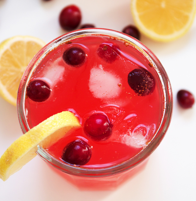 Holiday Cranberry Lemonade with tart lemons, sweet cranberry simple syrup and a touch of cinnamon