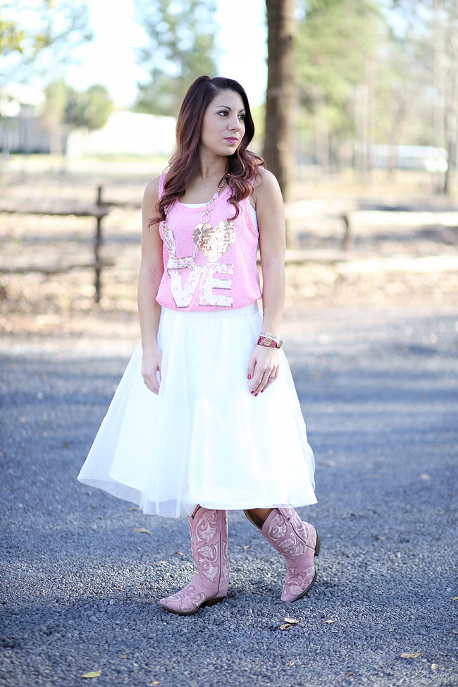 Soft pink and white outfit with cowboy boots