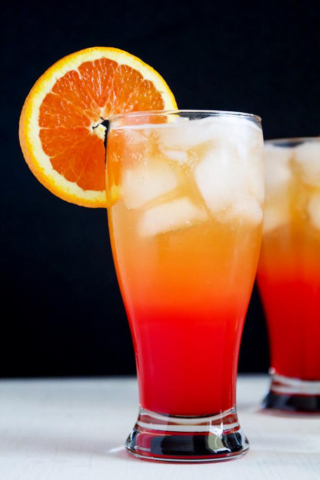 Corona Sunrise Cocktails with an Orange Wheel Garnish