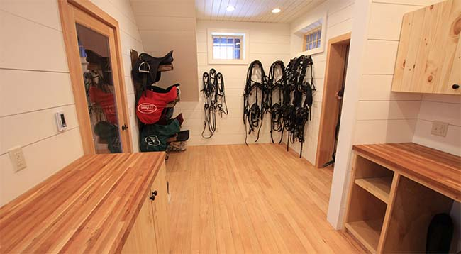 Bright and spacious light wood tack room