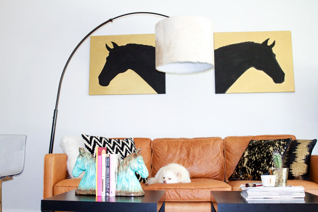 A modern equestrian influenced living room with a DIY cowhide lampshade