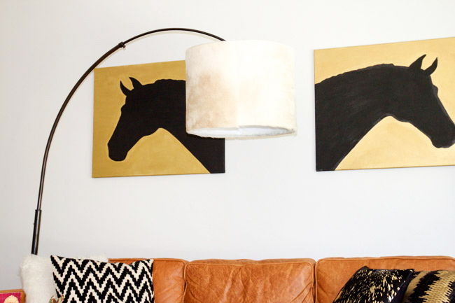 Gold and black horse art and a DIY cowhide drum lampshade