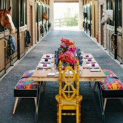 A table set in the horse barn for the dinner party