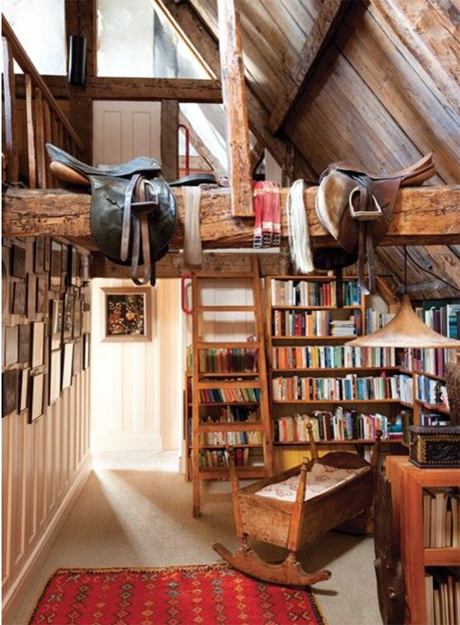 English saddles hanging from beams in a library room