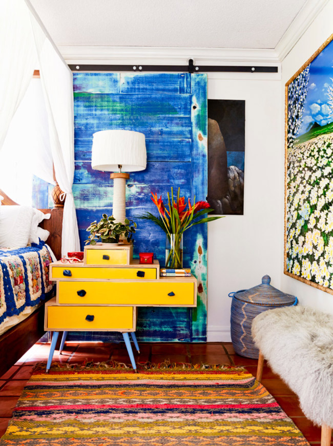Bright and colorful blue and yellow bedroom