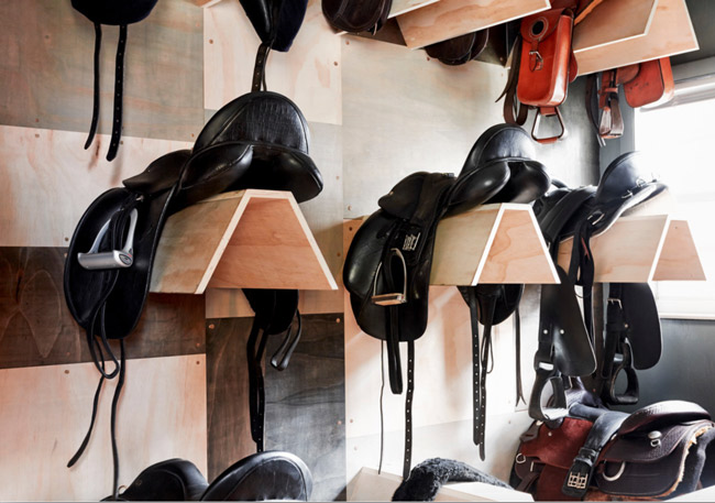 Clean english saddles in the tack room