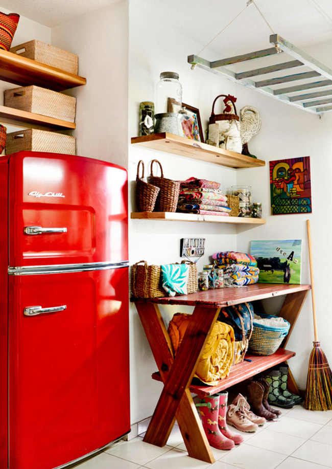 Mudroom and entry area with a vintage red fridge