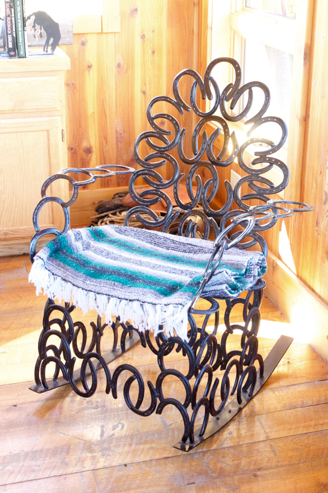 A western rocking chair made entirely of horseshoes