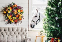 Charming rustic Christmas decor and a grey horse