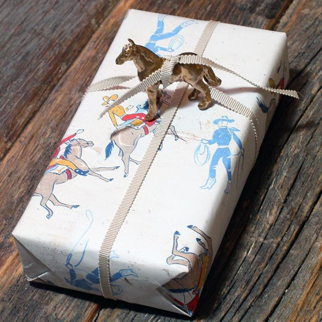 Cowboy wrapped gift with a horse figurine