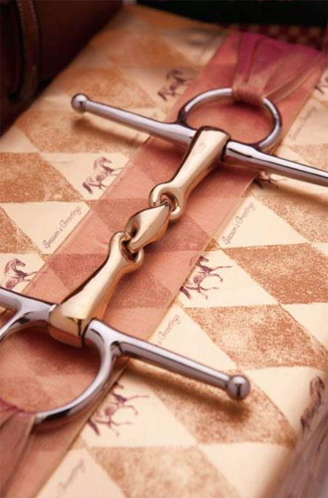 Horse print wrapping paper with a snaffle bit and ribbon