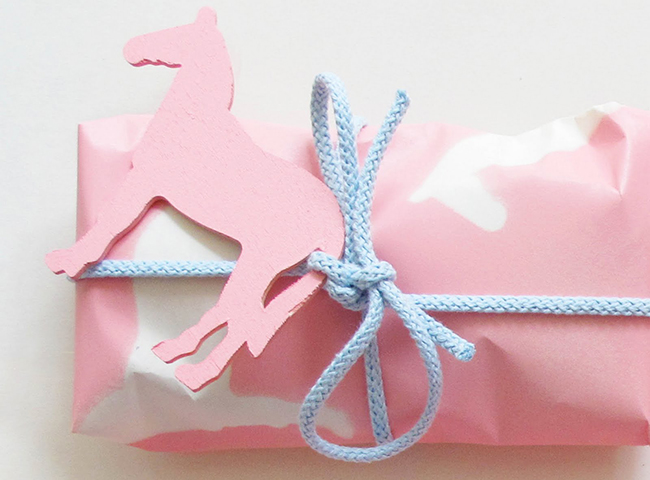 Pink horse cut out and pink wrapping paper