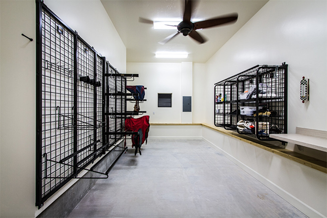 Clean and bright tack room with lots of space