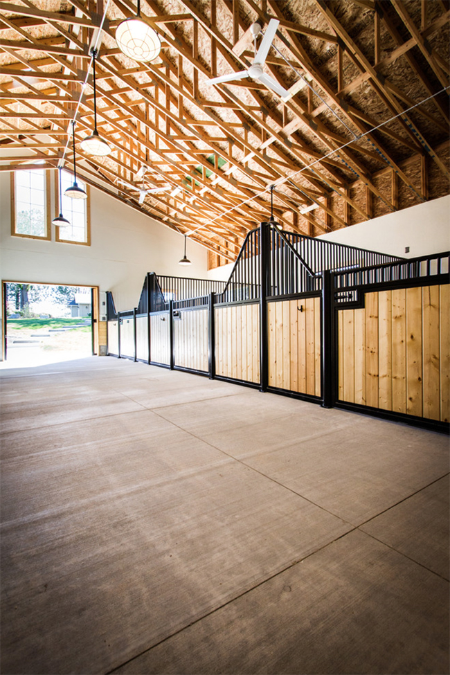 Interior of the horse barn has high ceilings