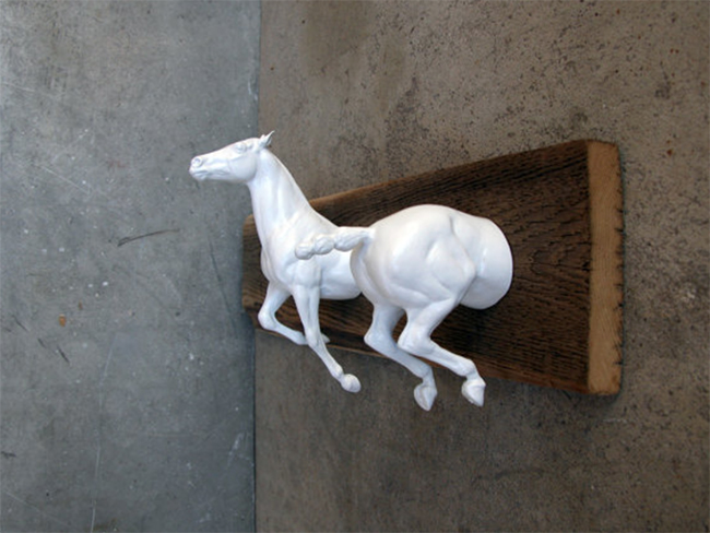 White Breyer horses attached to reclaimed wood