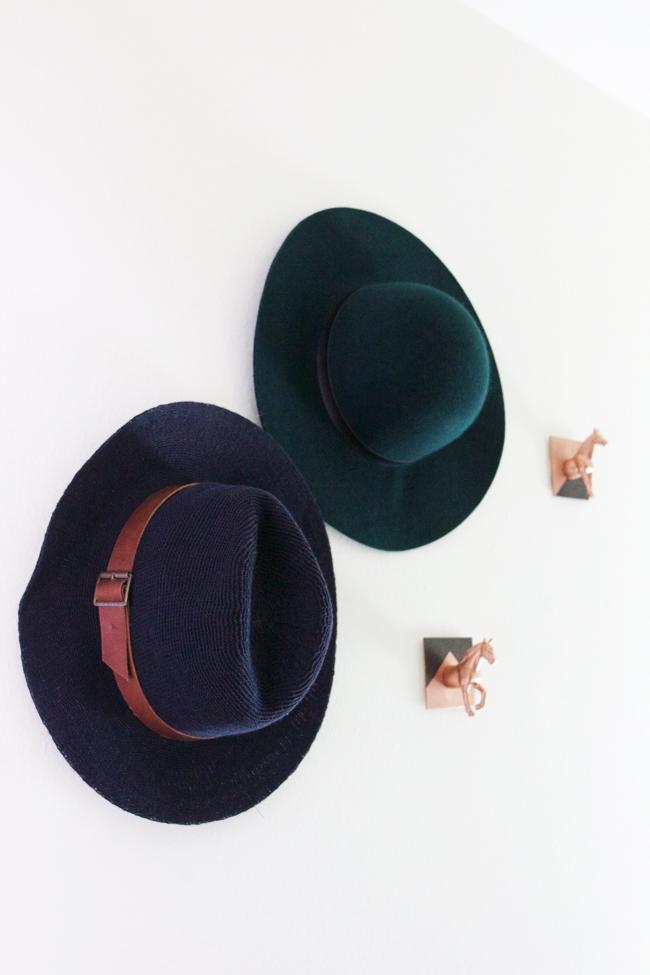 Hats hanging on DIY horse head hooks