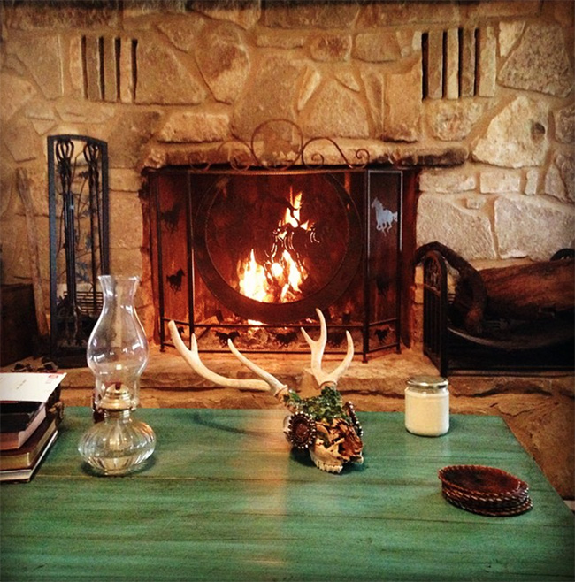 A cozy fireplace at The Sugar & Spice Ranch