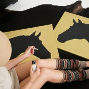 DIY gold and black silhouette horse art touch ups