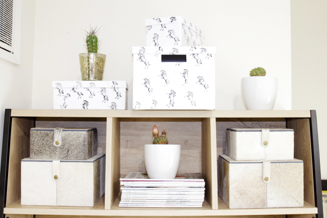 Neutral and organized office space with horse print and cowhide boxes