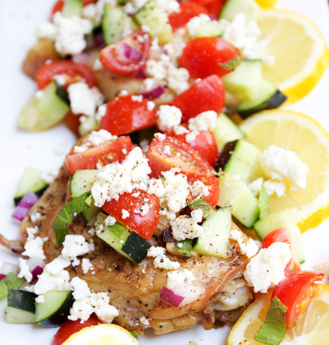 Mediteranean skillet chicken breasts with feta, tomato, and cucumbers. Serve with fresh lemon