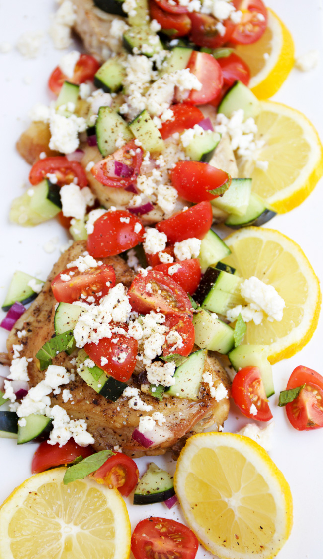 Mediteranean skillet chicken with feta, tomato, and cucumbers. Serve with fresh lemon
