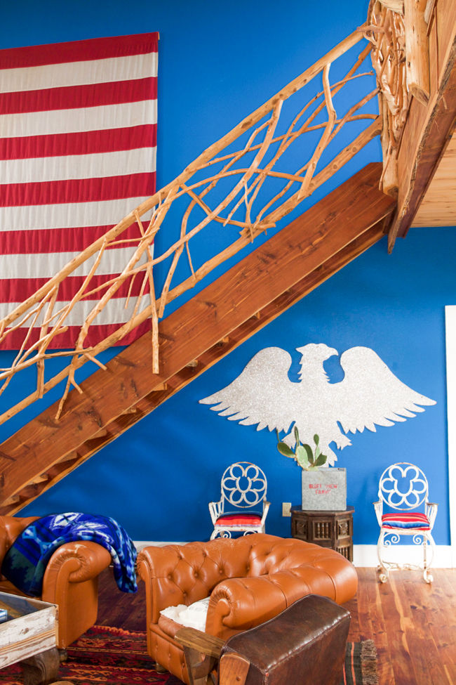 bright blue accent wall, rustic steps, and the flag
