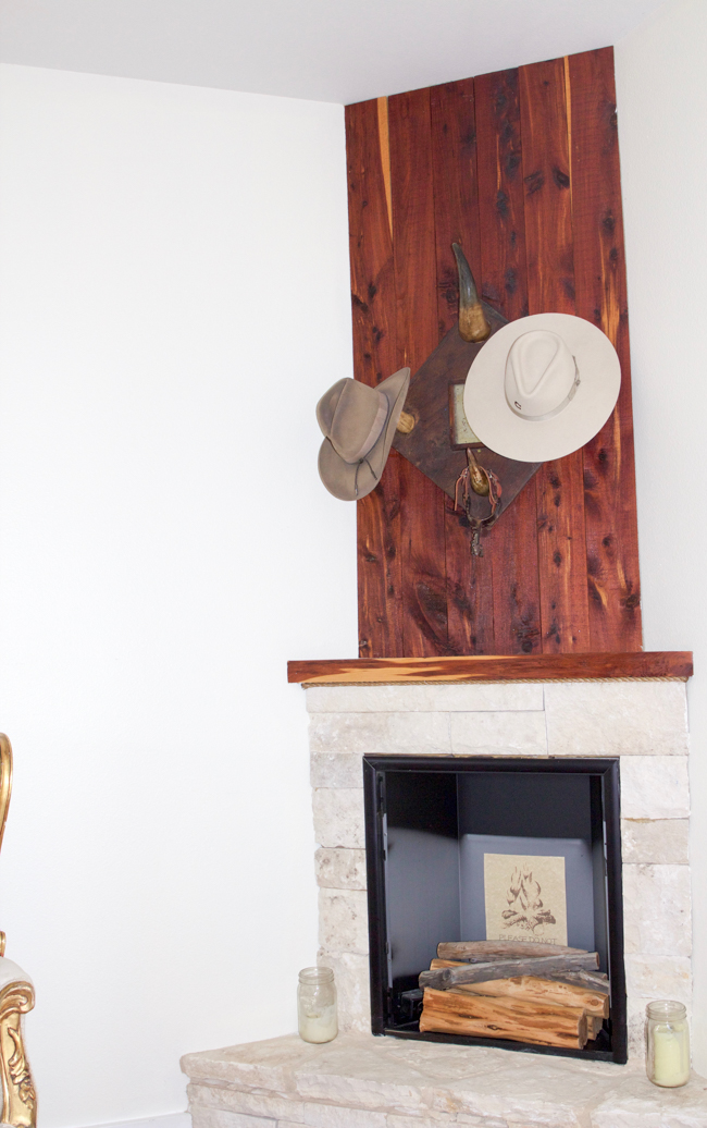 Charlie 1 Horse hats hanging above the fireplace