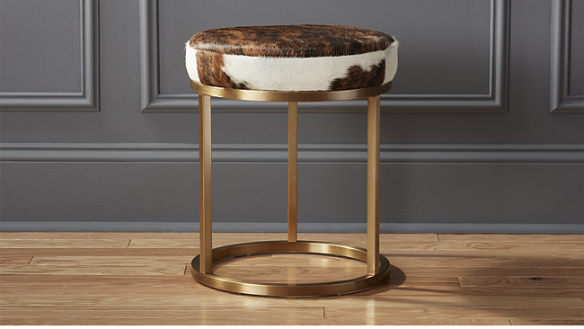 brass brown and white cowhide stool