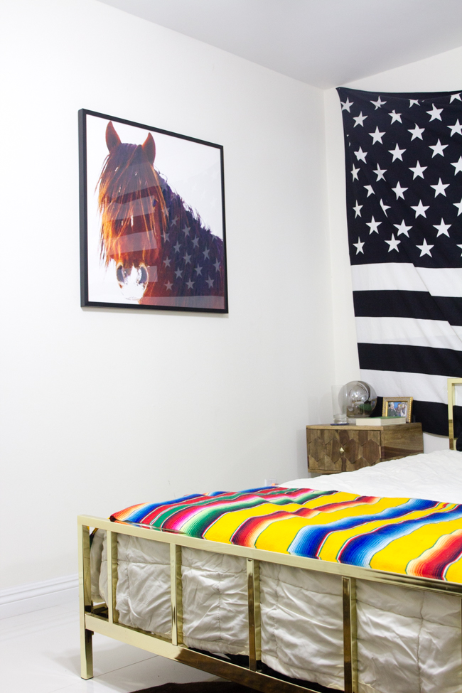 modern western bedroom with horse art