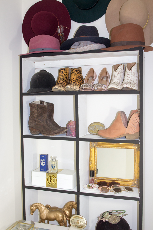 Organized shelf of shoes, hats, perfume, and accessories