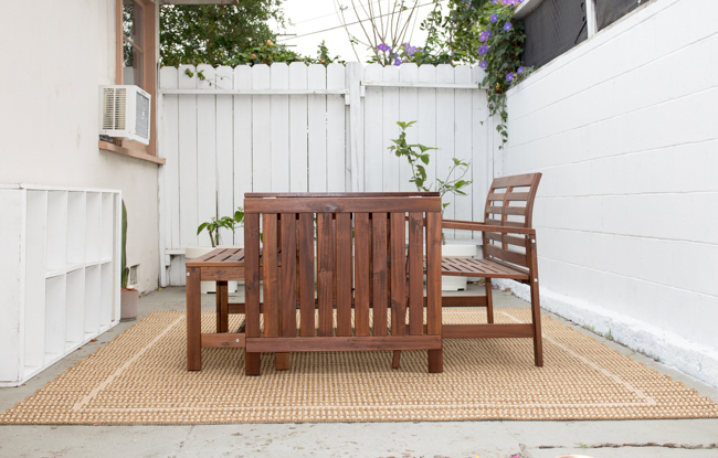 An addition of an outdoor rug frames the space