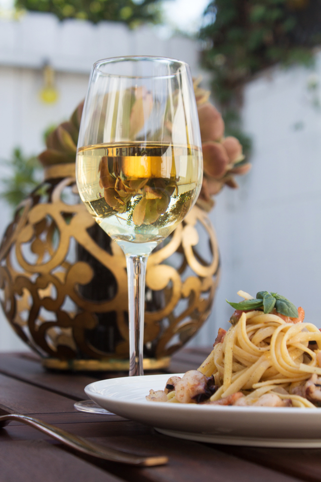 A nice glass of chardonnay and seafood pasta